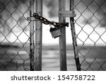 Gate Locked With Padlock At...