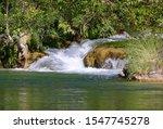 A waterfall cascading into Fossil Creek; Fossil Creek Wilderness in Arizona