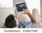 mature man lying on a sofa in a ... | Shutterstock . vector #154827485