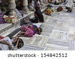 Small photo of DELHI, INDIA - AUGUST 06: The sick, infirm, elderly, and the devout at the ancient Sufi Mosque in Nizamuddin on August 06, 2011 in Delhi, India.