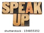 Small photo of speak up - motivation concept - isolated text in letterpress wood type