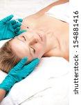 beauty woman giving facial... | Shutterstock . vector #154881416