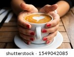 female hands holding a cup of... | Shutterstock . vector #1549042085
