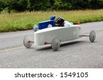 Two soap box derby cars speed...