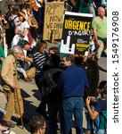 """Small photo of MONTREAL, CANADA - SEPTEMBER 27 2019: Old Couple Walking Beside Man Holding """"Emergency To Act/ Act Now, We Dare You"""" Sign Banner among Crowd Marching for Climate During Demonstration in Downtown"""