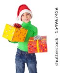 Smiling little boy in Santa's hat with two gift boxes in hands, isolated on white - stock photo