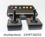 Small photo of london, england, 05/05/2018 A Retro vintage atari flashback 3 arcade console re issue. A modern plug and play console with a retro 1980s style. classic vintage arcade play.