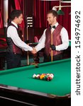 pool players. two cheerful... | Shutterstock . vector #154974692