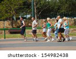Eight People Jogging In The...