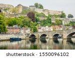 Meuse river with Jambes bridge and Citadel of Namur fortress on the hill, Namur, Wallonia, Belgium