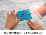 Small photo of Conceptual hand writing showing 2019 Summary. Business photo text brief comprehensive especially covering the main points of 2019 Hand hold note paper near writing equipment and smartphone.