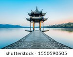 """Jixian pavilion during sunrise in Hangzhou, Zhejiang province, China with all Chinese words on it only introduces itself which means """"Jixian Pavilion """"without advertisement."""