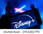 Small photo of Grand Prairie, TX/USA Oct 2019: Disney Plus on smartphone screen with Star Wars in the background. Dinsey+ is a new streaming subscription service that will feature Marvel, Pixar, and Star Wars.