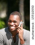 a handsome african american man talks on his cell phone - stock photo