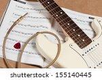 Score And White Electric Guita...