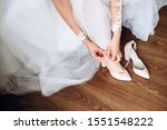 The Bride Puts On Wedding Shoes....