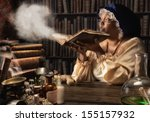 Medieval Alchemist Blowing Dus...