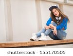 stylish girl lying on the bench ... | Shutterstock . vector #155170505