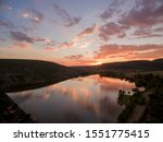 Small photo of PURPLE SUNSET whir clouds mirrored clouds