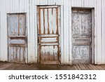 Old Shabby Doors On The White...