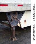 Small photo of Semi truck trailer landing gear and crank.