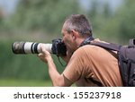 Photographer In Action With ...