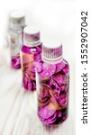 Stock photo rose hip petal oil concept brown dropper bottle with scattered dark pink rosehip petals and in 1552907042