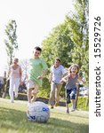 family outdoors playing soccer... | Shutterstock . vector #15529726