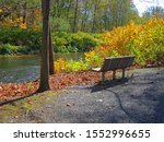 Brodhead Creek, in the fall with empty bench, is a 21.9-mile-long tributary of the Delaware River in the Poconos of eastern Pennsylvania in the United States.