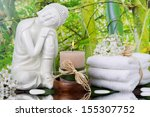 Buddha Figurine With A Stack Of ...