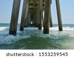 Small photo of Pier pilings under Pensacola fishing pier on the tropical gulf coast of Florida
