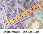 Small photo of Debenture Business and Financial as concept on Indian currency notes.