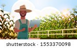 man farmer with tablet... | Shutterstock .eps vector #1553370098