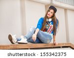 stylish girl lying on the bench ... | Shutterstock . vector #155342375