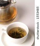 a cup of green tea from a pot | Shutterstock . vector #1553485