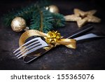 Table Setting With Gold And...