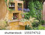 old cupboard with flowers... | Shutterstock . vector #155374712