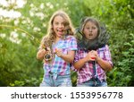 We have caught it. kids spend time in camp. having fun. fish angler. two girls fishing. Big game fishing. summer hobby. happy children with net and rod. summer holidays weekend. Fly Fishing Time. - stock photo