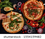 pizza and ingredients on a... | Shutterstock . vector #1554159482