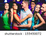 Stock photo happy young friends dancing at disco 155450072