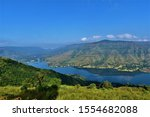 A Beautiful tourist destination, a valley with blue water river / lake, green hill / mountain on backdrop and blue sky. swituated in Panchgani mahabaleshwar, Maharashtra