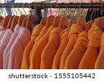 many hoodie jacket hang in the... | Shutterstock . vector #1555105442