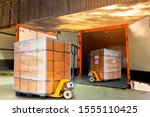 Small photo of Cargo freight, Shipment, Delivery service. Logistics and transportation. Warehouse dock load pallet goods into shipping container truck. Stacked package boxes on pallet inside a truck.