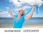 Happy Senior Woman Stretching...
