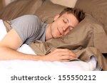 young man comfortably sleeping... | Shutterstock . vector #155550212