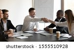 diverse smiling businesspeople... | Shutterstock . vector #1555510928