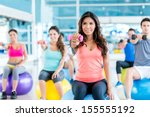 group of fit people at the gym... | Shutterstock . vector #155555192