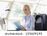 beautiful businesswoman working ... | Shutterstock . vector #155609195