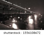 snow and rain in winter against ... | Shutterstock . vector #1556108672