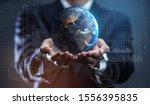 businessman holding earth.... | Shutterstock . vector #1556395835